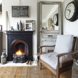 This gorgeous mirror frame was made from an old front door frame found in a salvage yard | via http://www.housetohome.co.uk/house-tour/picture/be-inspired-by-this-vintage-style-terraced-home/8